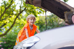Little boy looking at motor in family car Royalty Free Stock Photography