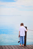 Little boy looking at ocean Stock Photography