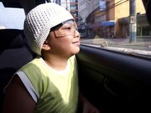 Little boy looking out a car window Royalty Free Stock Photo