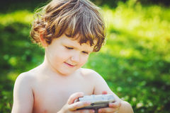 Little boy looking at the photo on the camera. Royalty Free Stock Photos