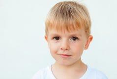 Boy looking at photographer Stock Photos