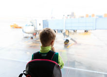 Little boy looking at planes in the airport Royalty Free Stock Photography