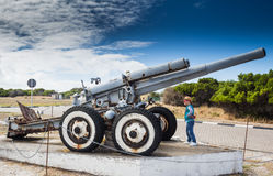 Little boy looking at the Second World War coastal defence howit Stock Images