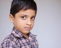 Little Boy Looking Serious Stock Photo