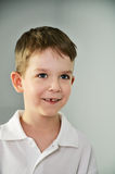 Little boy looking slyly. vertical portrait Stock Photos