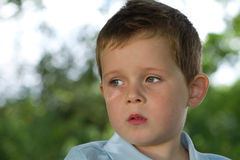Little boy looking to his right in countryside Stock Photos