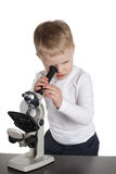 Little boy looking to microscope Royalty Free Stock Photos