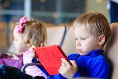 Little boy looking at touch pad in the airport Stock Image
