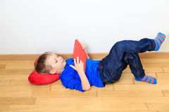 Little boy looking at touch pad Stock Image