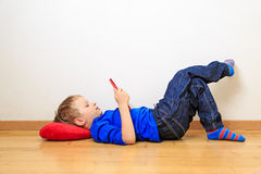 Little boy looking at touch pad Royalty Free Stock Image