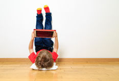 Little boy looking at touch pad Stock Images