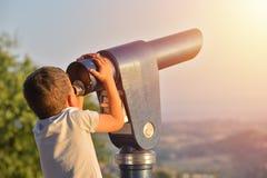 Little boy looking into tourist telescope eyepiece. Travel touri Royalty Free Stock Photos