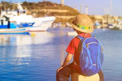 Little boy looking at traditional boats in Malta Stock Photography