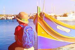 Little boy looking at traditional boats in Malta Royalty Free Stock Photography