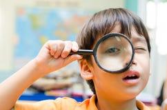 Little boy looking trough a binoculars Royalty Free Stock Image