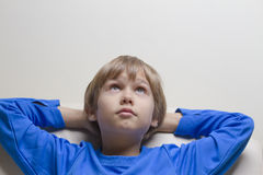 Little boy looking up while dreaming or thinking. Copy space for text Royalty Free Stock Images