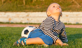 Little boy looking up at the sky Royalty Free Stock Photo