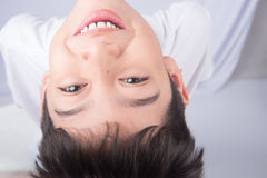 Little boy looking up with smiling on white background Royalty Free Stock Photography