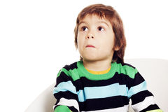 Little boy looking up with surprised face Royalty Free Stock Image