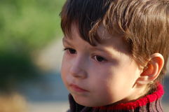 Little boy looking upset Royalty Free Stock Image