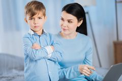 Free Little Boy Looking Upset Having Been Scolded By Mother Royalty Free Stock Image - 107025976