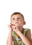 Little boy looking upwards stock image