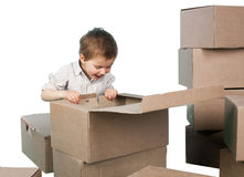 Little boy looks in a box Stock Photography