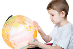 Little boy looks at the globe Royalty Free Stock Images