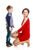 The little boy looks at his beautiful young mother Royalty Free Stock Image