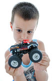 Little Boy Looks His Car Royalty Free Stock Image