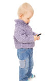The little boy looks in the mobile phone Royalty Free Stock Photos