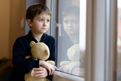 The little boy looks out the window Royalty Free Stock Images
