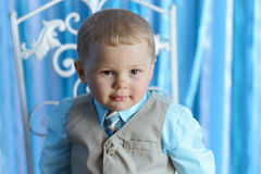 Little boy looks seriously Royalty Free Stock Images