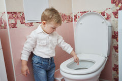 Little boy looks in toilet Royalty Free Stock Photography