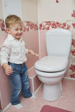 Little boy looks in toilet Royalty Free Stock Images