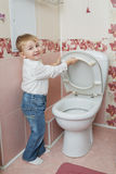 Little boy looks in toilet Royalty Free Stock Photo