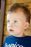 Little boy looks up. Cute little blue-eyed boy looks up Royalty Free Stock Photo