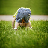 The little boy looks upside down Royalty Free Stock Photos