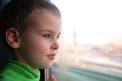 Little boy looks in window royalty free stock photo