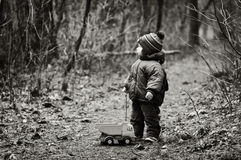 Little Boy Lost In a Forest. Little Boy With a Car Toy Got Lost In a Forest Royalty Free Stock Photos