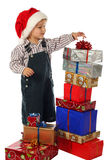 Little boy with lot Christmas gift boxes Royalty Free Stock Photography