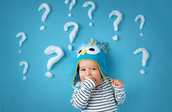 Little boy with lots of question marks Stock Images
