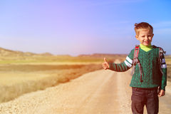 Little boy loves travel on the road Stock Photo