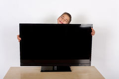 Little boy loves TV Royalty Free Stock Photos