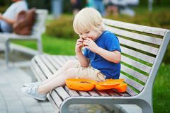 Little boy with lunchbox and healthy snack stock photography