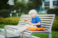 Little boy with lunchbox and healthy snack Stock Photo