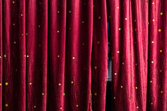 Little boy lurking behind the stage curtains Stock Photography