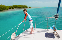 Little boy at luxury yacht Royalty Free Stock Image