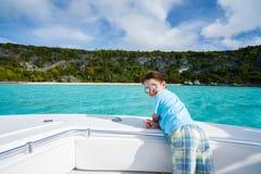 Little boy at luxury yacht Stock Image