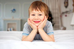 Little boy lying on the bed Royalty Free Stock Photo